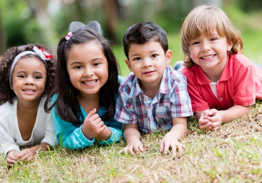 Children on the grass smiling
