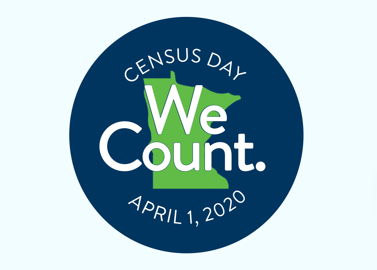 "Navy circle with the shape of Minnesota in green at center with the words ""Census Day, We Count. April 1, 2020"""